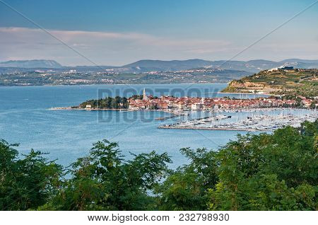 Panoramic View Of Slovenian Coast Town Izola In Adriatic Sea Before Sunset With Visible Italian Coas