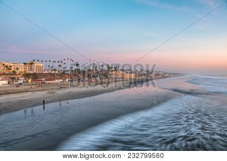 View Of The Beach From The Pier At Sunset, In Oceanside, California