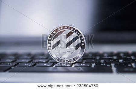 Litecoin Coin On A Laptop. Litecoins Crypto Currency On A Laptop Black Keyboard. Digital Currency. V