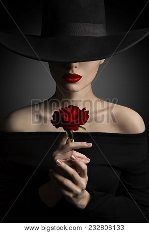 Woman In Hat Holding Rose Flower In Hands, Fashion Model Beauty Portrait, Red Lips And Black Wide Br