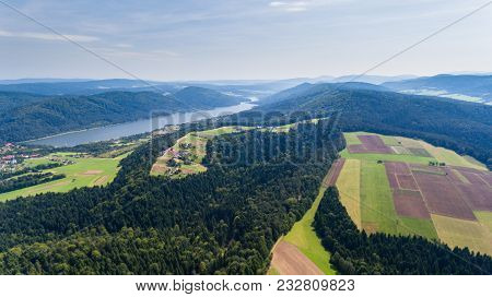 Landscape With Lake, Fields, Forest And Farmland. Drone View From Above