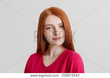 Serious Good Looking Freckled Young Female Model, Has Freckles On Face, Long Straight Red Hair, Dres