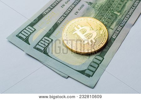 Golden Bitcoins On Us Dollars. Digital Currency Close-up. New Virtual Money. Crypto Currency Top Vie