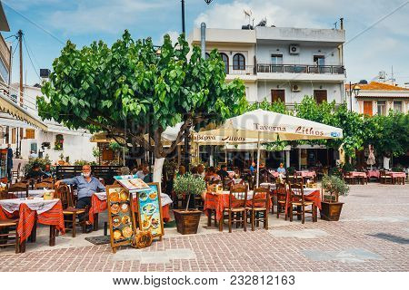 Mochos, Crete - June 13, 2017: Tavern Lithos On The Main Square In The Village Of Mochos On Crete Is