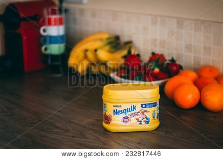 March 25th, 2018, Cork, Ireland - Nestlé Nesquik Container On Top Of A Wooden Table With Healthy Fru