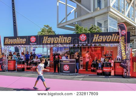 Limassol, Cyprus - October 1, 2017:  Havoline Oil Exhibit At A Car Show With Young Lad Passing By An