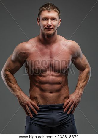 Big Muscled Man Posing Showing His Pumped Muscules