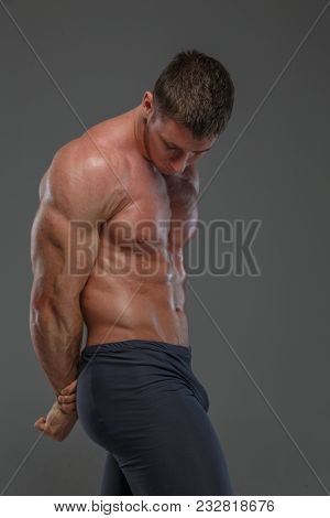 Bodybuilder Male Posing Showing His Huge Muscules