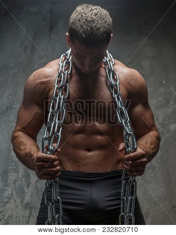 Bodybuilder Male With Pumped Musculed Body Holding Steel Chain