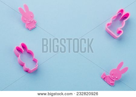 Rabbit Shaped Pink Silicone Molds. Silicone Molds For Cookies Baking On Blue Background And Copy Spa
