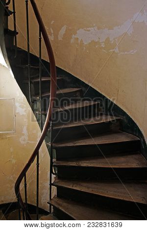 Wooden Ancient Spiral Staircase In Old Building. Str. Croissant 13-15, Paris, France. August 31, 201