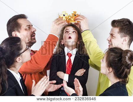 A Group Of People In Business Attire Crowns A Small Shocked Boy In A Business Suit, The Concept Of R