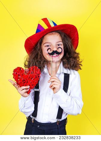 Boy With A Mustache And A Heart In His Hands, April Fool's Day. Valentine's Day, March 8, Internatio