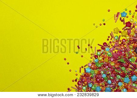 Abstract Colorful Background. Colorful Candies On Yellow Background With A Lot Of Copy Space For Tex