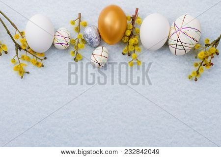 Easter festive background, copy space. Row of Easter eggs with pussy willow twigs on light blue background, space for text. Easter spring decor. poster
