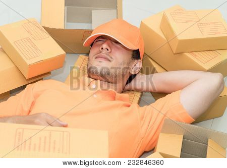 Delivery Man Is Relaxing Taking A Nap On Boxes
