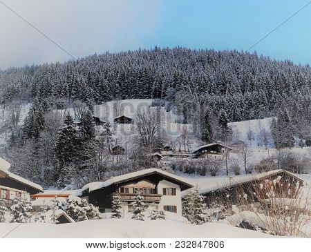 Chalets After The Snow. Traditional Alpine Ski Chalets Dot The Mountain Landscape Of The Austrian Al