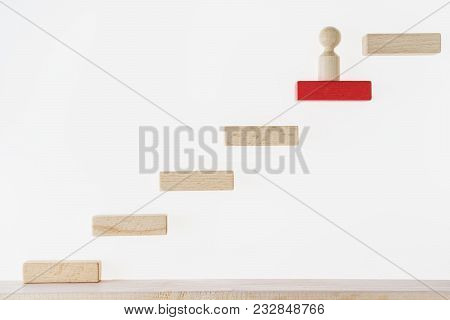Career Concept. Business Metaphor. Concept Of Business Learning Success. Man Climbs The Stairs. Achi