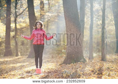 Girls Who Train And Listen To Music In Headphones In The Morning Autumn Park. Jumping On A Rope. Goo