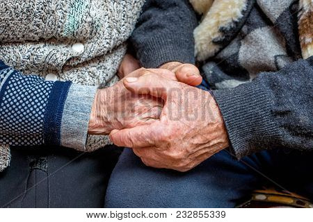 Grandfather And Grandmother Joined Hands; The Manifestation Of Love, Affection And Care In Old Age