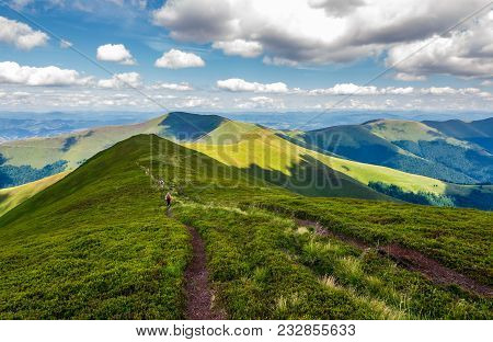 Footpath Through Mountain Ridge In Summer. Group Of Tourists Following The Path. Lovely Landscape An