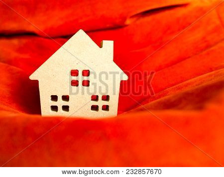 Wood Home Toy On Vivid Orange Fabric. Build Home Or Home Loan Concept.