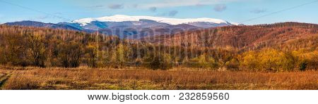 Springtime Countryside With Snowy Mountain In The Distance. Lovely Panorama Of Runa Mountain In Even