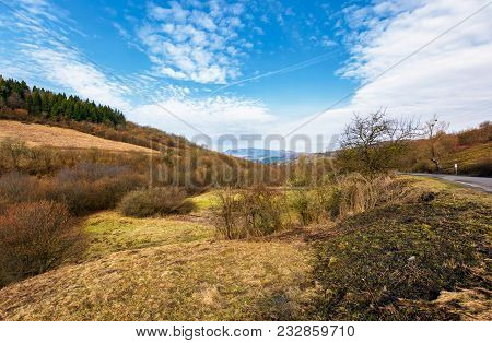 Rural Fields On Mountain Slopes In Springtime. Beautiful Countryside Scenery By The Road. Mountain R