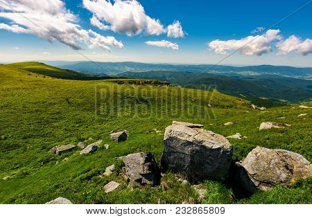 Gorgeous Mountain Landscape On A Summer Day. Giant Boulders On A Grassy Hillside Under The Beautiful
