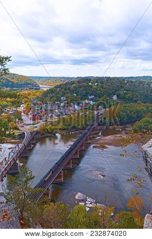 Aerial View On Harpers Ferry Historic Town And The Rail Bridge From The Park Overlook. Railroad Brid