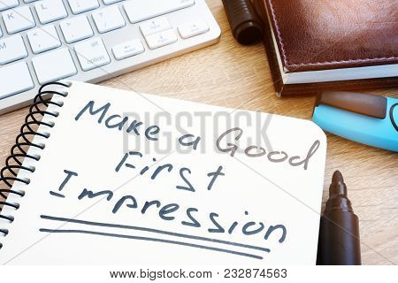 Make A Good First Impression Handwritten In A Notepad.