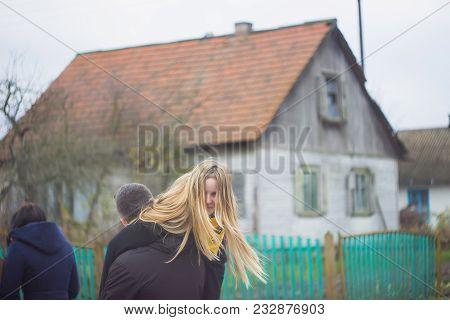 Zhytomyr, Ukraine - October 19, 2017: Girlfriend And Boyfriend Having Fun Outdoor , Young Man Wearin