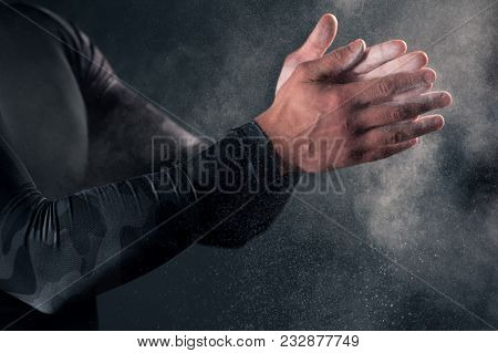 Close-up - Young Man Clapping Hands With Chalk Powder Before Workout In Gym. Fitness, Sports Concept