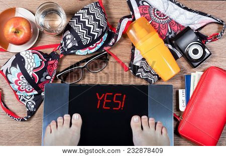 Digital Scales With Female Feet And Sign Yes! Surrounded By Summer And Vacation Accessories, Apple A