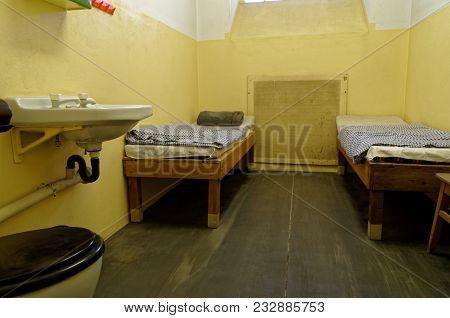 Leipzig, Germany - June 12, 2015. Jail Cell With Two Bunk Beds And Sink Are Exposed In The Stasi Mus