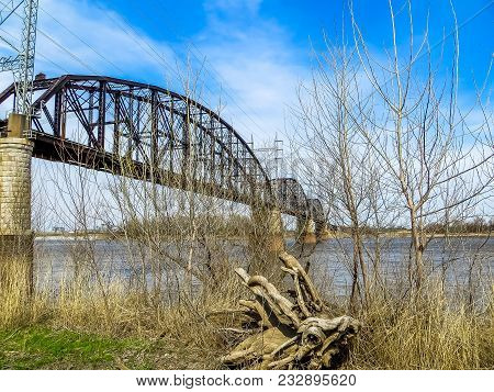 Saint Louis, Mo Usa - 04/12/2014 -  Mississippi River Bank With Industrial Bridge