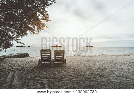 Two Empty Recliners On The Coastline With The Pier On The Left And Ocean Horizon In Front; Daybeds O
