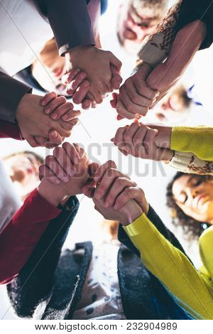 People Hodling Each Other By Hands. Support Concept. Toned .
