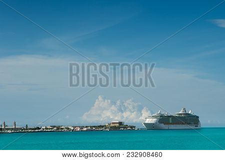 Cruise Ship Docked In Beautiful Blue Bermuda Water