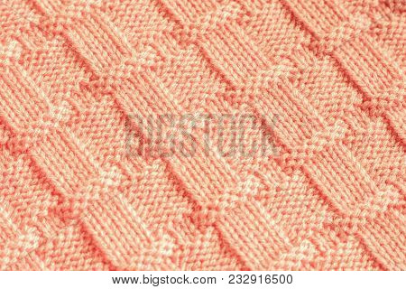 Knitting Fabric Made Of Wool Yarn Peach Color With Geometric Pattern. Knitted Cloth Needles, Handmad