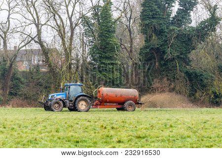 Day View Tractor Fertilizer Sprays On British Field.