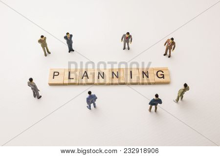 Miniature Figures Businessman : Meeting On Planning Letters By Wooden Block Word On White Paper Back