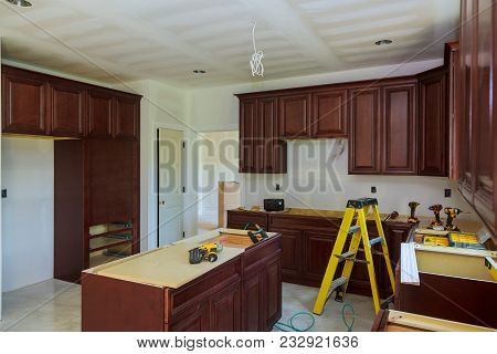 Installing New Induction Hob In Modern Installation Of Kitchen Cabinet. Kitchen Remodel Beautiful Ki