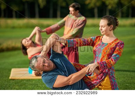 Traditional Thai Massage Therapy. Impact On Shoulders For Caucasian Mature People.