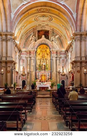 Lisbon, Portugal - October 24, 2016: Catholic Priest conducting mass on Santo Antonio de Lisboa Church. Built on the Saint Anthony of Lisbon aka of Padua or Padova birth location. Baroque style