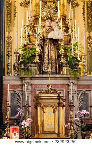 Lisbon, Portugal - October 24, 2016: Saint Anthony statue and Tabernacle in the Santo Antonio de Lisboa Church altar. Built on the Saint Anthony of Lisbon aka Padua or Padova birth location. Baroque.