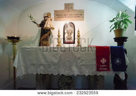 Lisbon, Portugal - October 24, 2016: Crypt interior marking the birthplace of Saint Anthony of Lisbon aka Padua or Padova, beneath the Santo Antonio de Lisboa Church. Altar with statue and reliquary