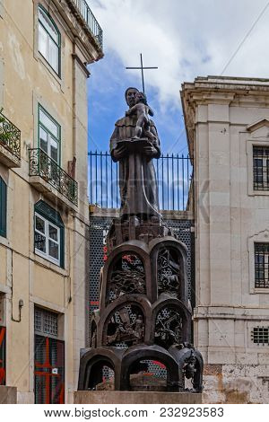 Lisbon, Portugal - October 24, 2016: Saint Anthony of Lisbon Statue aka Padua or Padova in front of the Santo Antonio de Lisboa Church built on the saint birth location. By Domingos Soares Branco