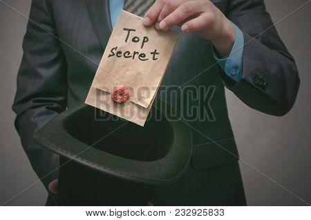 Top Secret Concept. Top Secret Documents Or Message In Businessman Hands. Confidential Dossier Infor