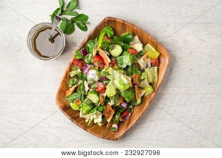 Fattoush Salad Top Flat Lay View. The Key Ingredient In This Middle Eastern Dish Is The Toasted Pita